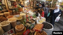 Iraqis shop at a market in Baghdad in preparation for Ramadan.
