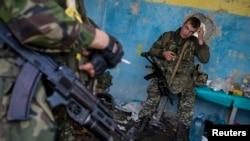 Pripadnici ukrajinske nacionalne garde na kontrolnom punktu u regionu Luganjska