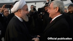 Armenia - President Serzh Sarkisian (R) greets his Iranian counterpart Hassan Rouhani at Yerevan airport, 21Dec2016.