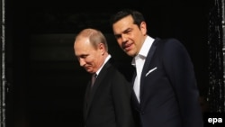 Greek Prime Minister Alexis Tsipras (right) talks with Russian President Vladimir Putin during their meeting in Athens, Greece, on May 27.