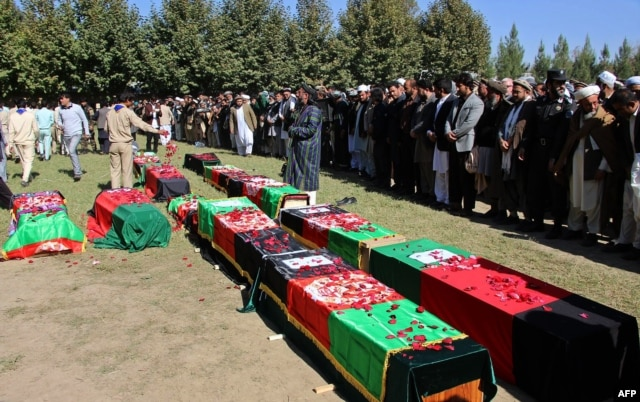 Funeral services were held for 12 Afghan schoolgirls who died trying to flee their school during the quake.