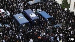 Прощание с погибшими при нападении на синагогу в Иерусалиме.