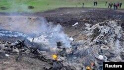 Кулаган учактын калдыктары күйүп жатат, Чүйдүн Панфилов району, 3-май, 2013.