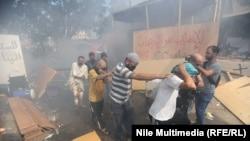 Разгон лагеря сторонников смещенного президента в Каире, 14 августа 2013 года