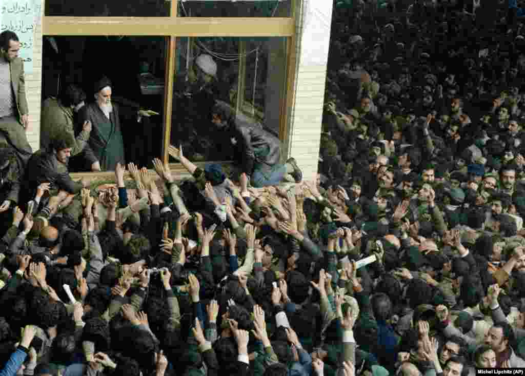 Khomeini addresses crowds with his son Ahmad on February 4, 1979.