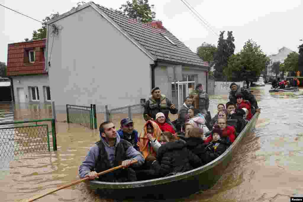 Serbian soldiers evacuate people in a boat in the flooded town of Obrenovac, southwest of Belgrade, on May 17. (Reuters/Marko Djurica)