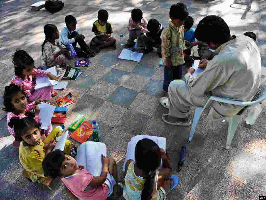Students attend school in Islamabad, Pakistan. About 45 percent of the population is illiterate. - Plan B emphasizes stabilizing global population by 2020 in order to reduce the demand on natural systems. Population stabilization includes many components that would be included in the plan's $185 billion annual budget. The plan includes $10 billion a year for global, universal primary education.