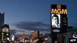Marquees on the Las Vegas Strip, including the MGM Grand Hotel & Casino, show video tributes to billionaire investor Kirk Kerkorian on June 16, 2015.