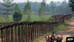 An Indian farmer on a cart passes along the line of control in Kashmir. (file photo)