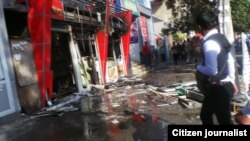 Место взрыва на центральном рынке Джалал-Абада. 9 октября 2013 года. Фото предоставлено гражданским активистом Нурбеком Жолборсовым