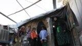 عائلة مرحّلة في مخيم أم البنين في بغداد