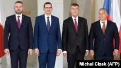 (Left to right:) Slovak Prime Minister Peter Pellegrini, Polish Prime Minister Mateusz Morawiecki, Czech Prime Minister Andrej Babis and Hungarian Prime Minister Viktor Orban pose for photo at the start of a Visegrad summit in Prague on September 12.