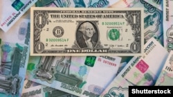 Russia – One American dollar on the background of Russian roubles 1000 bills