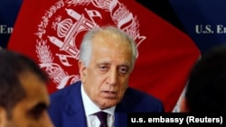 U.S. special envoy for peace in Afghanistan, Zalmay Khalilzad, talks with local reporters at the U.S. embassy in Kabul in November.
