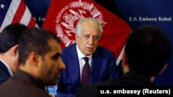 U.S. special envoy for peace in Afghanistan Zalmay Khalilzad talks with local reporters at the U.S. Embassy in Kabul in November.