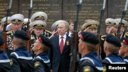 Ukraine - Russian President Vladimir Putin (C) stands with military personnel during a ceremony marking Victory Day, in Sevastopol, Crimea, May 9, 2014