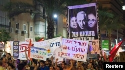 Activists holding placards during a rally in Tel Aviv on July 30 against rising property prices.
