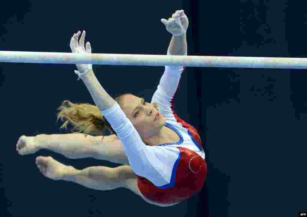 Russia's Kseniia Afanaseva competes on the uneven bars in the women's individual artistic gymnastics qualification during the fifth European Men's and Women's Artistic Gymnastic Individual Championships in Moscow on April 18. (AFP/Natalia Kolesnikova)