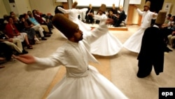 Whirling dervishes dance during a performance for tourists in Istanbul, Turkey, in 2007 to mark the 800th anniversary of the founder of the Mevlevi Sufi Brotherhood, poet Mevlana Jalal al-din Rumi.