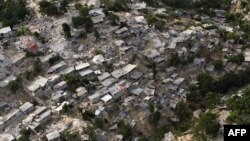 The destruction to a poor neighborhood in Port-au-Prince