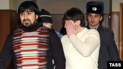 Three Chechen men, Magomed Dukuzov's brother Kazbek (left), Musa Vakhayev (right), and Fail Sadretdinov (behind), were acquitted of the killing in May 2006.