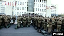 Armenia - Military personnel lined up in front of the Defense Ministry building in Yerevan, 10Mar2014.
