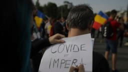 Imagine de la unul dintre protestele celor care nu cred în existența coronaviruslui