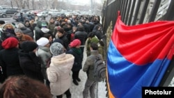 Armenians protest in front of the National Assembly building against the ratification of the controversial gas agreement with Russia in Yerevan on December 23.