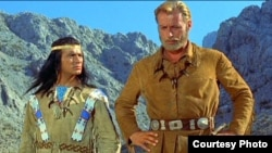"A scene from ""Schatz im Silbersee"" with Pierre Brice (left) as Apache chief Winnetou and Lex Barker as Old Shatterhand"