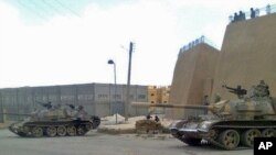 A mobile-phone photo purporting to be of Syrian army tanks in the eastern Syrian province of Deir el-Zour, provided by Shaam News Network.