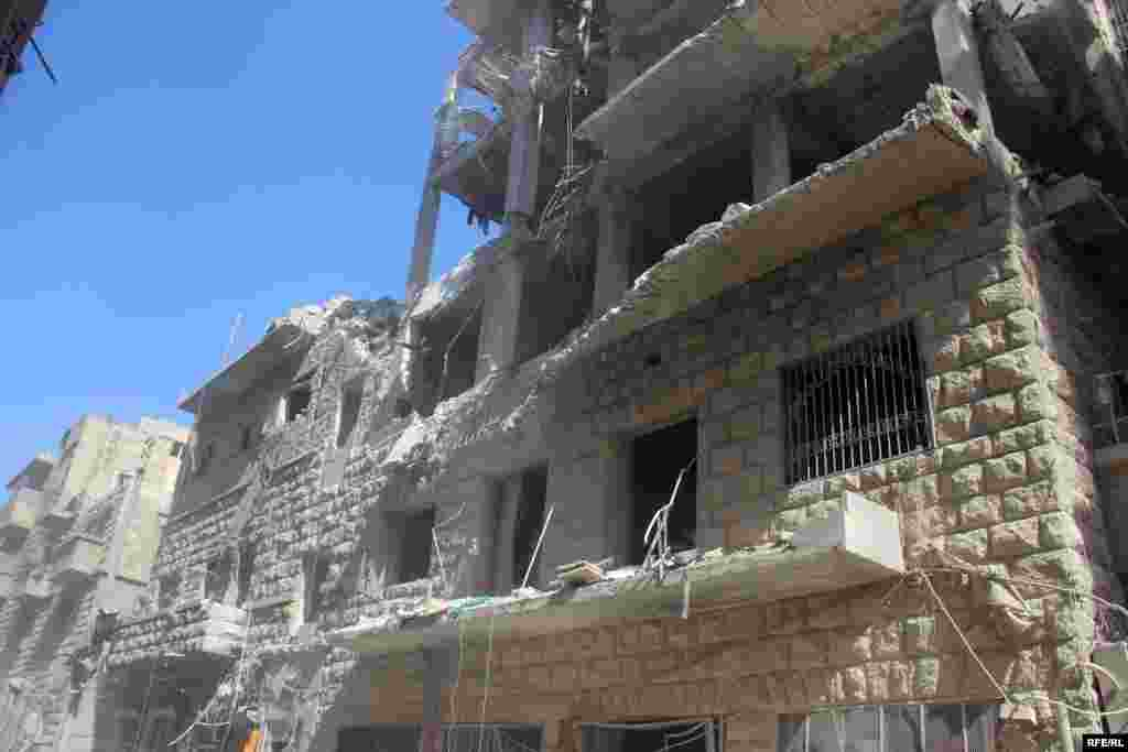 A shattered building in Aleppo's Bustan al-Qasr district on October 11. The British-based Syrian Observatory for Human Rights said around 250,000 people remained trapped in the besieged city.