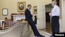 Претседателот Барак Обама и директорот на ЦИА Џон Бренан.