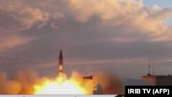 A TV grab taken on September 23 from state broadcaster IRIB shows a Khorramshahr missile being launched from an undisclosed location, a day after the missile was first displayed at a high-profile military parade.