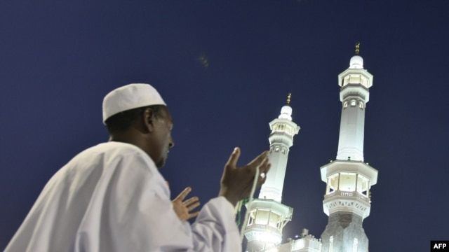 A Muslim pilgrim prays outside the Grand Mosque in Mecca, Saudi Arabia. Under King Abdullah, the kingdom has moved toward a more inclusive form of Islam.