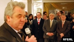 Anatol Plugaru (left, at a book launch in this file photo) is a former director of Moldova's intelligence service and an ex-parliament deputy.