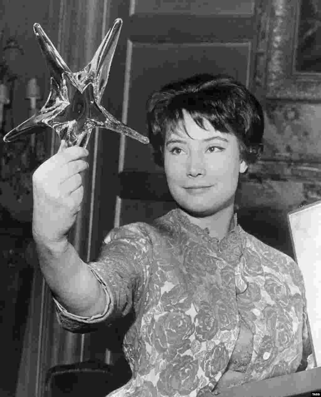 "Tatyana Samoilova pictured in Paris in 1961 with an Etoile de Cristal prize for best international actress, which she won for her role in ""The Cranes Are Flying."""