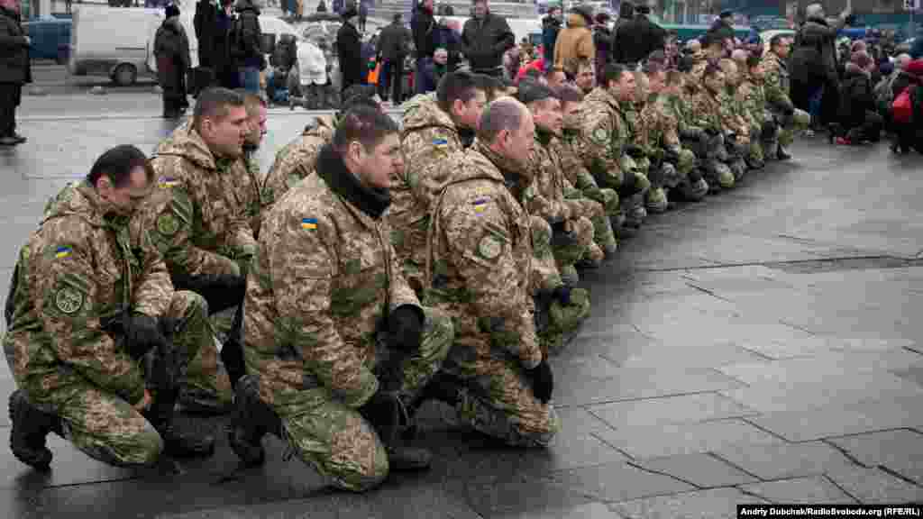Soldiers mourn the deaths of seven colleagues during funeral services on Kyiv's Independence Square.