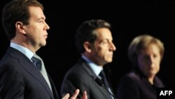 """""""I believe we have a good chance to restart the process and achieve results,"""" said Russian President Dmitry Medvedev (left), with French President Nicolas Sarkozy and German Chancellor Angela Merkel in Deauville on October 19. """"Russia will support this."""""""