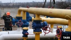 "A worker checks the gas-distribution system ""Donetsk 1"" in Donetsk, in eastern Ukraine, on March 3."