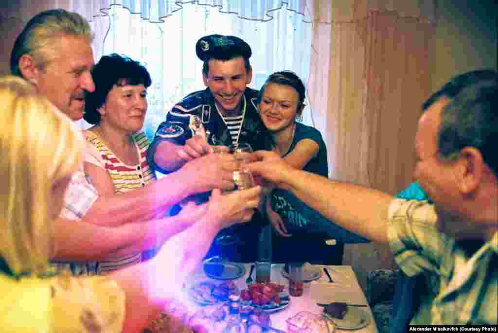 A family celebration welcomes a soldier back to normal life at home.