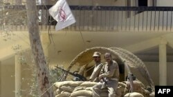 Pjesëtarë të armatosur të grupit Mujahedeen-e-Khalq në Irak (fotografi nga viti 2003)