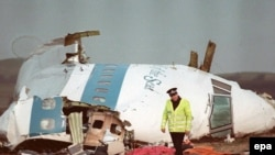 A policeman walking next to the wreckage of the Pan Am 747 Boeing cockpit a day after the plane exploded over Lockerbie, Scotland in December 1988.