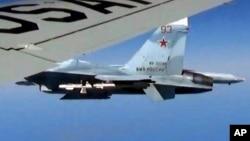 Російський Су-27 під час одного з попередніх небезпечних зближень над Балтикою, того разу з американським літаком-розвідником, фото 19 червня 2017 року