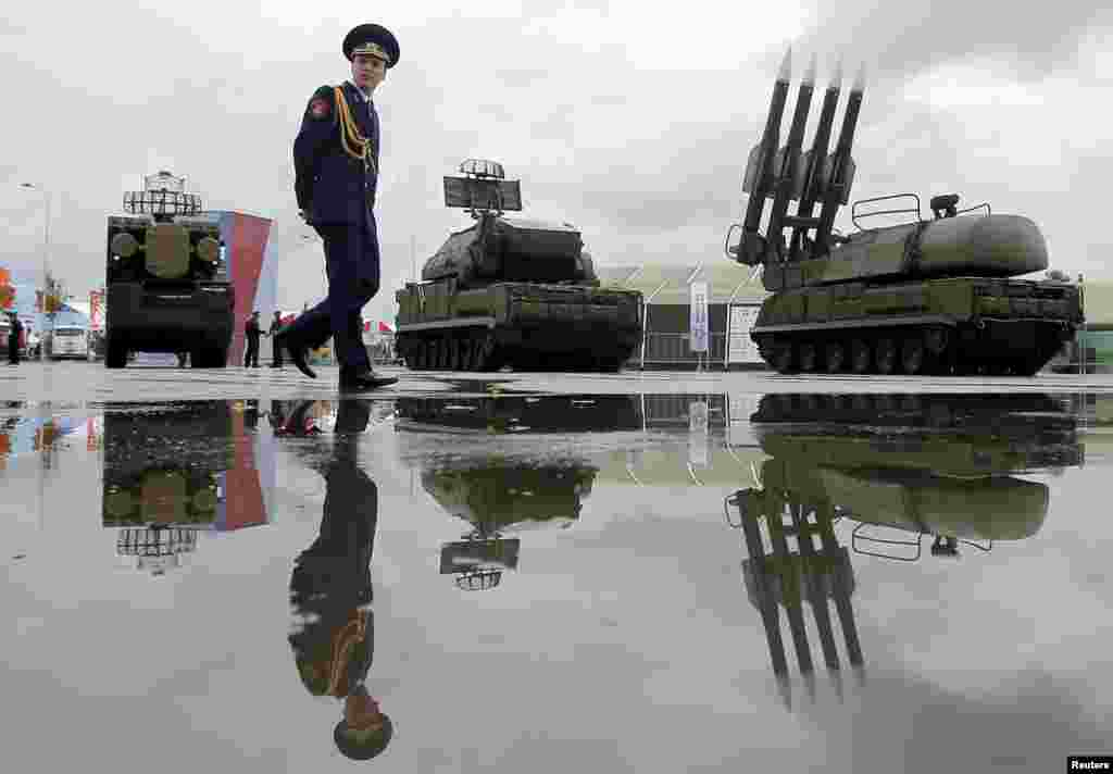 A Russian serviceman walks past a Buk-1M missile system at the Army-2015 international military forum in Kubinka, outside Moscow. (Reuters/Maksim Shemetov)