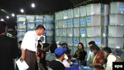 Independent Election Commission (IEC) workers recount ballots in Kabul. (file photo)