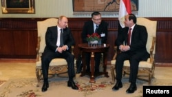 Egypt's President Abdel Fattah Al-Sisi (right) talks to Russian President Vladimir Putin (left) during their meeting at Cairo International Airport on February 9.