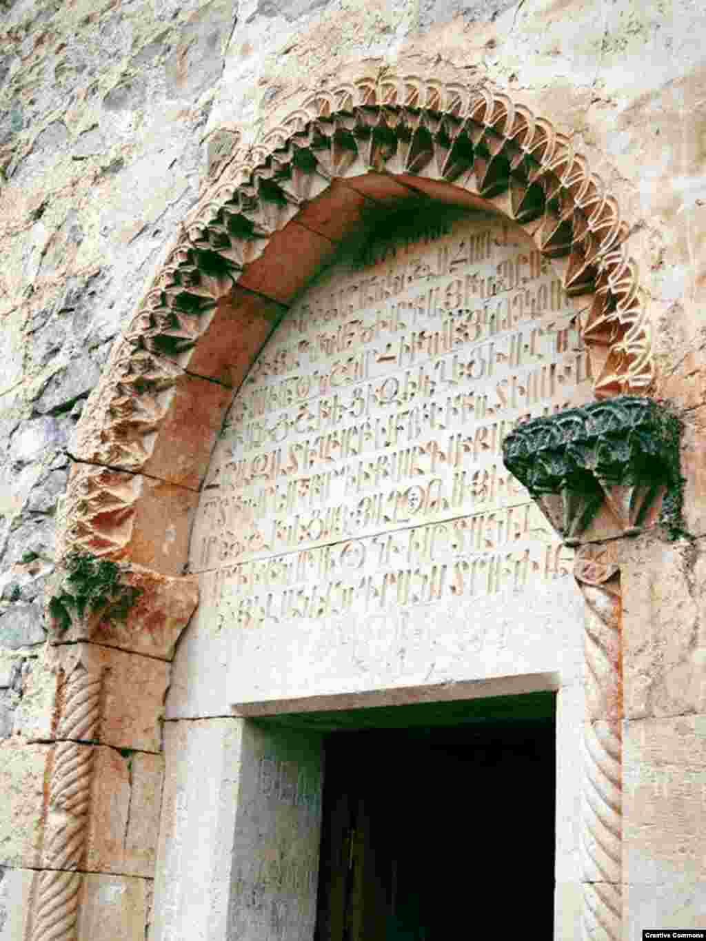 Armenian script towers over the door at an entrance to the Yeritsmankants monastery. The partially ruined monastery was built in 1691.