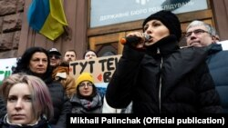 Parliamentary deputy Sofia Fedyna (holding the microphone) near the building of the State Bureau of Investigations on February 12.