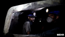 Iran -- Iranian coal miners in a track inside a coal mine in Tabas in Yazd Province, undated