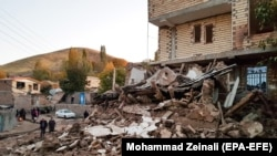 Buildings lie damaged in a village in Iran's East Azerbaijan Province following an earthquake on November 8.
